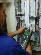 picture of a person testing an electrical installation using a test instrument